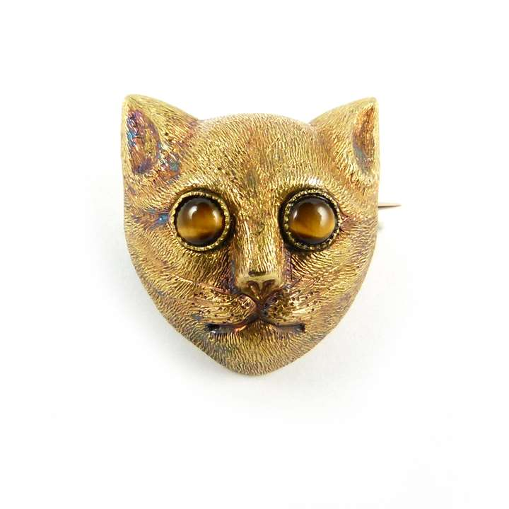 Antique textured gold cat's head brooch with tiger's eye set eyes